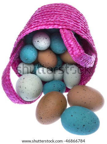 Pink Easter basket overflowing with Easter eggs isolated on white with a clipping path. - stock photo