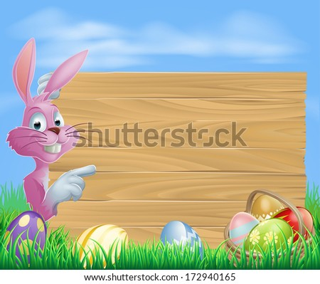 Pink Easter eggs bunny rabbit with chocolate painted Easter eggs and a blank wooden sign