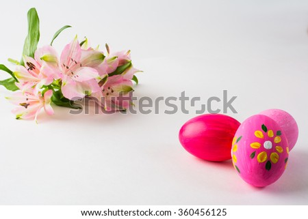 Pink Easter eggs with floral design and pink flowers on a white background. Easter background. Easter background. Easter symbol. Copy space - stock photo