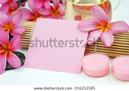 Pink empty memo paper with Pink Frangipani on white background - stock photo