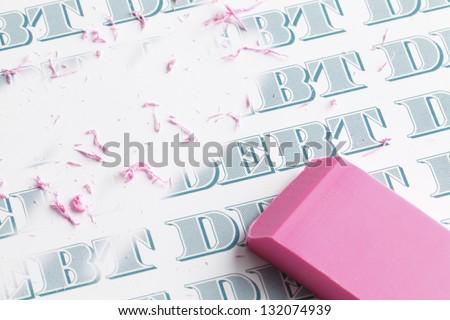 Pink eraser erasing multiple debts written in money font. - stock photo