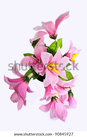 pink fake flowers is isolated on a white (top view) - stock photo