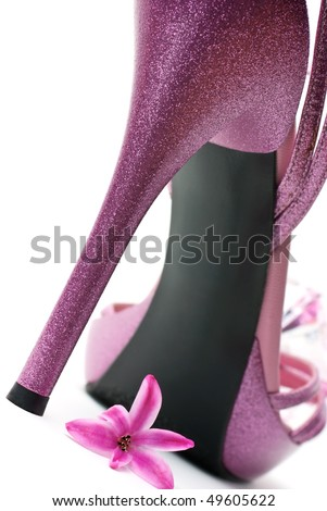 Pink fashion high heels shoe on white background (macro) - stock photo