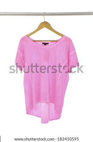 Pink female shirts on wooden hangers  - stock photo