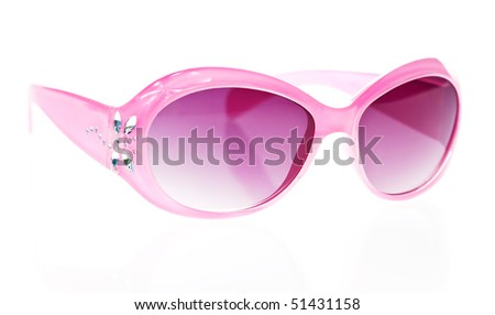 Pink female sunglasses in a white background - stock photo