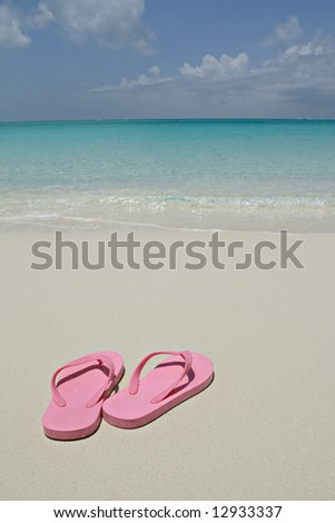 Pink flip flops in Turks and Caicos - stock photo