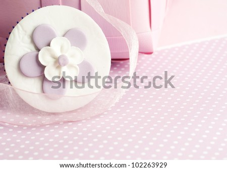 pink flower cupcake in romantic pink setting - stock photo
