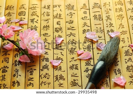 Pink Flowers and Brush on Chinese ancient bamboo slips - stock photo
