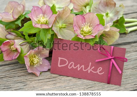 pink flowers and card with lettering thanks/thanks/Christmas Rose - stock photo