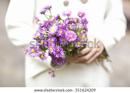 pink flowers in the hands
