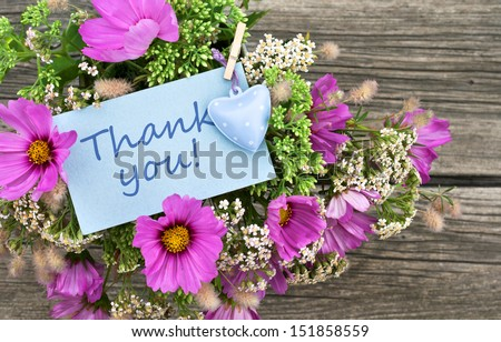pink flowers with card with lettering thank you/thank you/flowers - stock photo