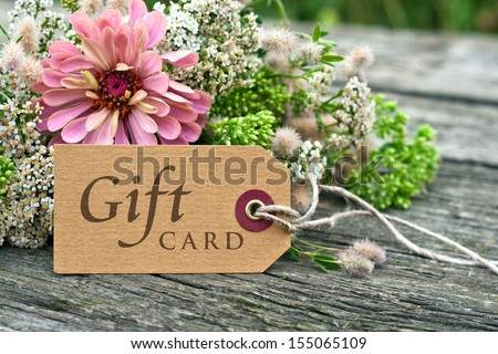 pink flowers with gift card/gift card/english - stock photo