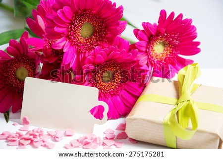 Pink flowers with present and card  - stock photo