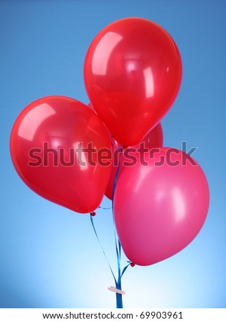 Pink flying balloons  on a blue background - stock photo