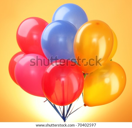 Pink flying balloons  on a yellow background - stock photo