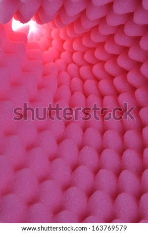 Pink foam acoustic, safe packaging material - stock photo
