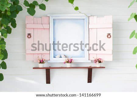 pink frame window with green leaves - stock photo