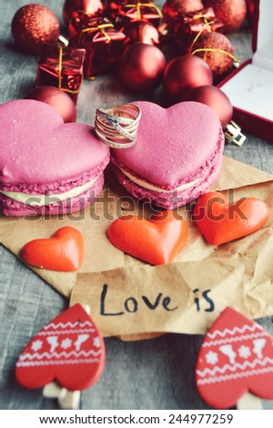 pink French macarons heart-shaped .love letter,Valentine,proposal,ring,red hearts,Valentine's day.wooden background