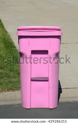 Pink Garbage Container on the Street - stock photo