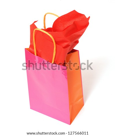 Pink gift bag and tissue on white - stock photo