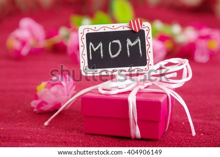 Pink gift box with signboard mother's day. - stock photo