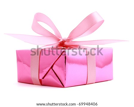 Pink gift wrapped present with rosy satin ribbon bow isolated on white - stock photo