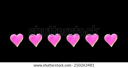 Pink  Gingerbread hearts Isolated on black background - stock photo