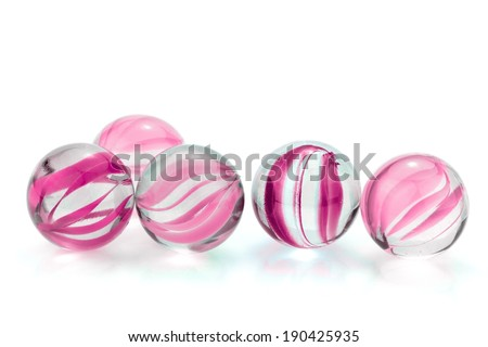 Pink, glass marbles isolated on white background - stock photo