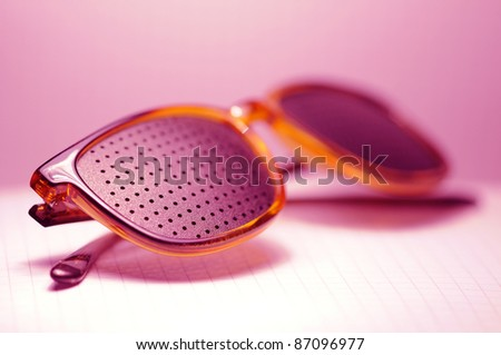 pink glasses on white, look - stock photo