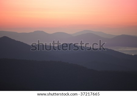 Pink glow above the Blue Ridge mountains at dawn