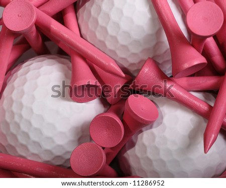 Pink Golf Tees set on white Golf Balls