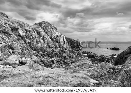 Pink granite cave on Kintra - Isle of Mull - stock photo