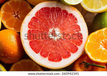 Pink grapefruit and other citrus fruit for a healthy breakfast. - stock photo