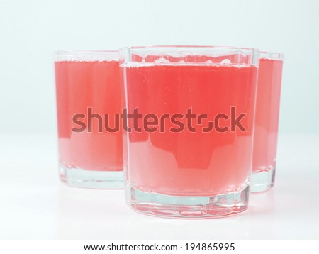 Pink grapefruit juice glasses on continental breakfast table