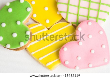 Pink, Green and Yellow polka dot heart shaped cookies - stock photo
