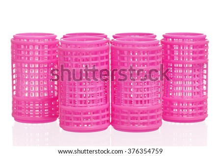 Pink hair curlers isolated on white background  - stock photo