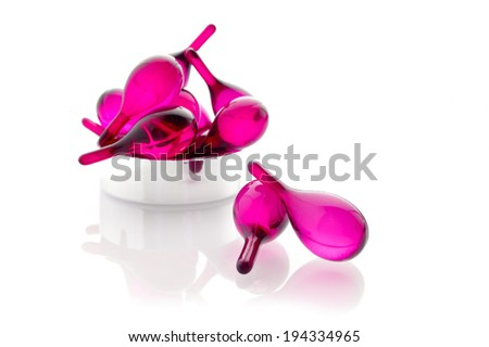 pink hair vitamin oil serum capsule isolated on white background  - stock photo