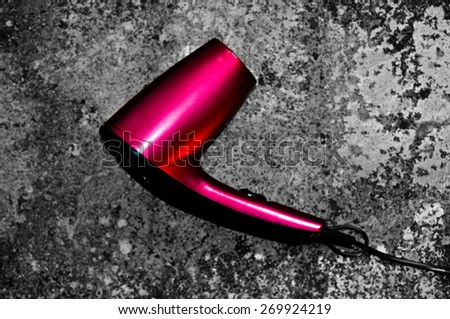 Pink hairdryer - stock photo