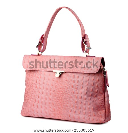 Pink handbag made of reptile skin isolated on white. - stock photo