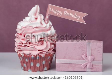 Pink happy birthday cupcake - stock photo