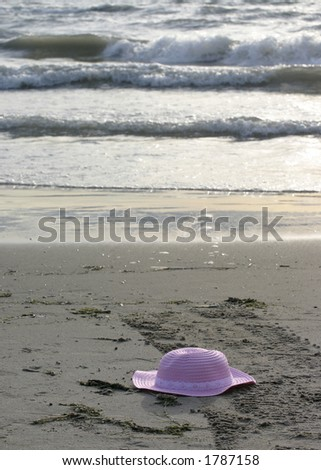 pink hat on the beach - stock photo