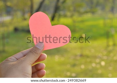 pink heart and hand valentines day background. - stock photo