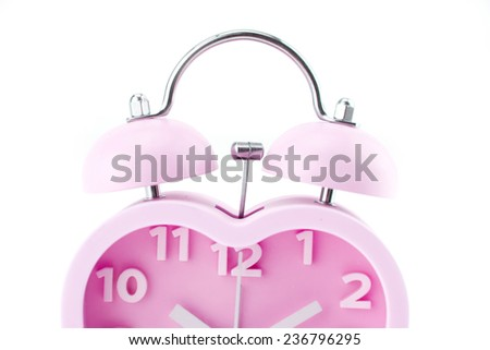 pink heart clock with bell on white background