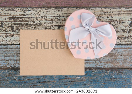 Pink Heart gift box and paper on vintage wood table for background - stock photo