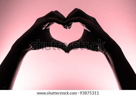 Pink heart hands silhouette - stock photo
