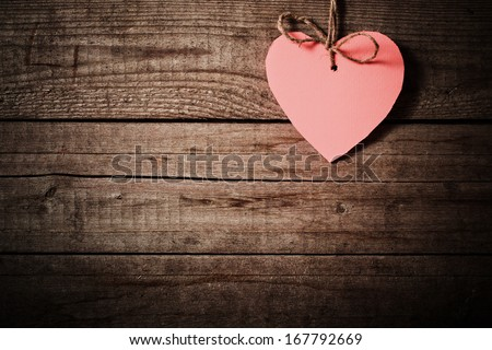 pink  heart made of paper on wooden background - stock photo
