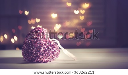 Pink heart on heart shaped abstract light background - stock photo