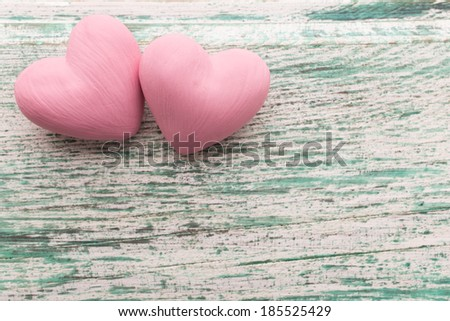 Pink heart on the wooden background. Provencal still.