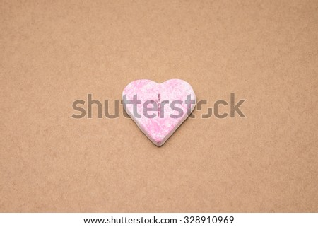 Pink heart shape with cross symbol for religion background - stock photo