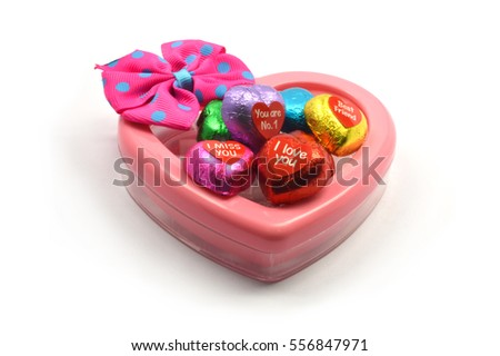 Pink heart-shaped box and message on chocolate heart with  white background, background for Valentine's day